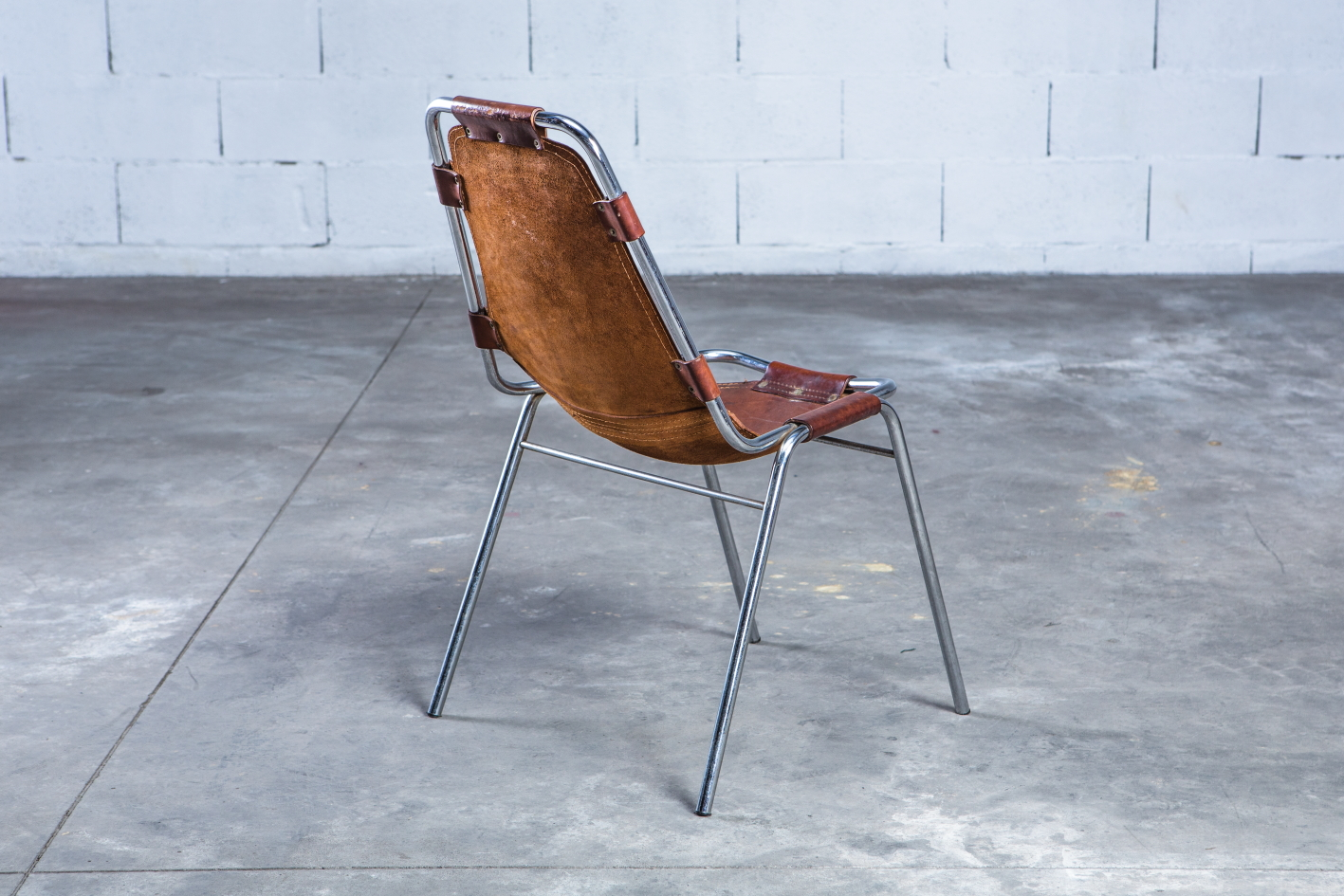 ''Les Arcs'' chairs - Charlotte Perriand - Leather and metal frame - 3/4 back view
