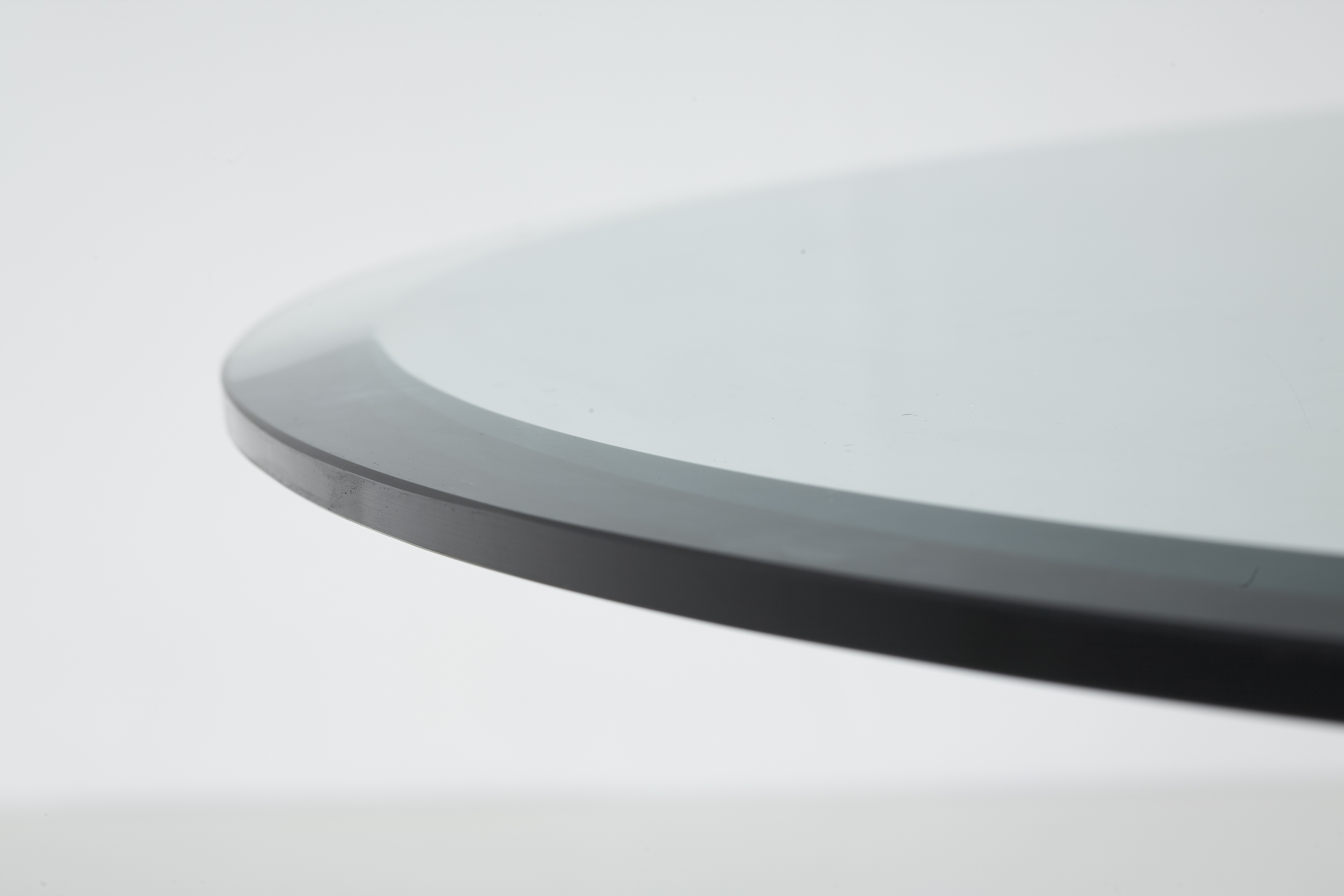 A round dining table by Angelo Mangiarotti - marble travertine and glass top